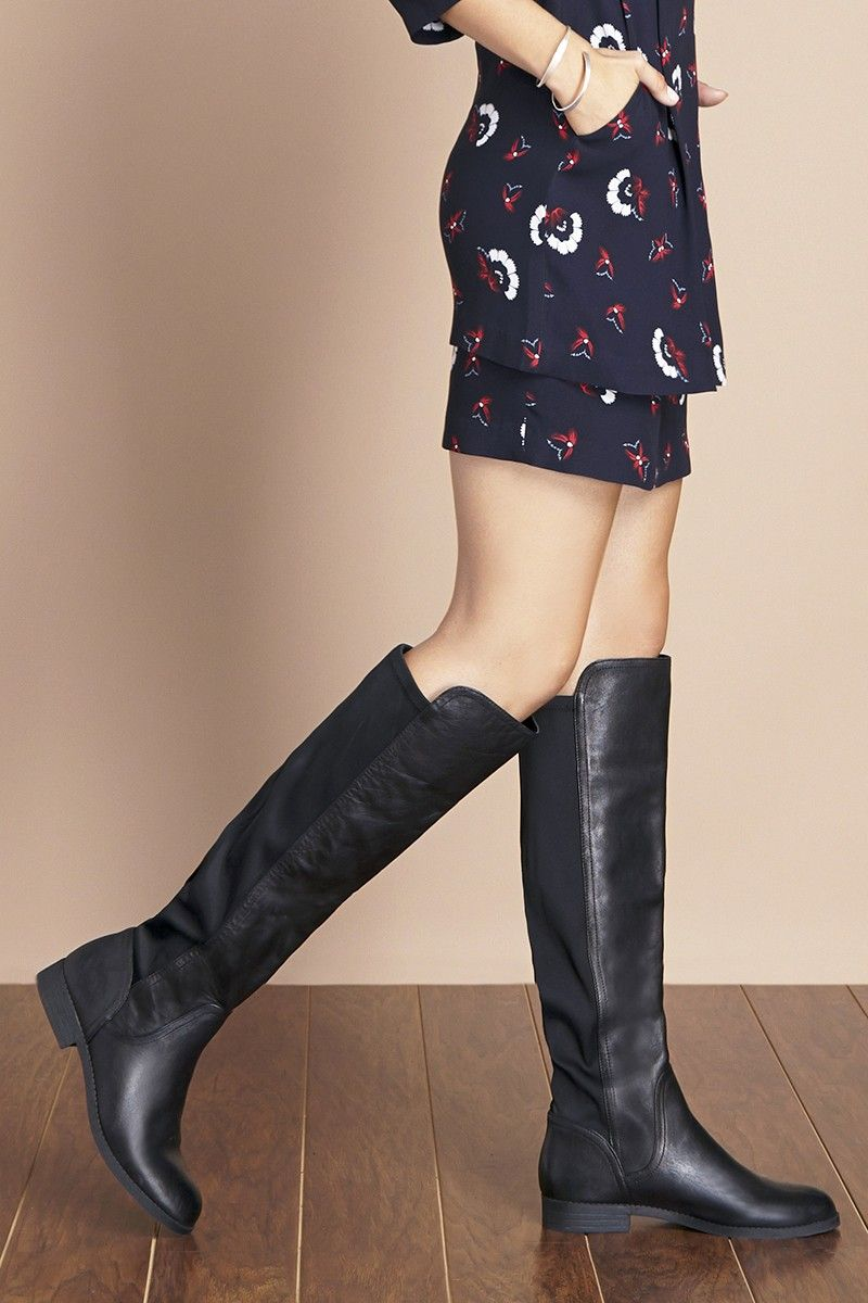 Black leather tall boots with easy stretch back by @solesociety