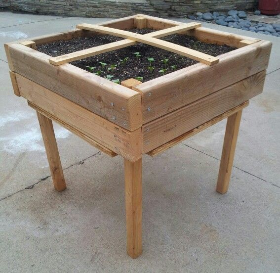 The Tiny Garden child's gardening planter box.  Click for the build plan.  I made a kit of these wooden pieces for my 4 year old son and we assembled it together.  Made with untreated 2x4s (walls), 2x2s (legs), plywood (floor), and lathes (cross on top).  Gives him four square feet to garden with using the Square Foot Gardening Method. He can reach everything with easy access for planting, watering, and weeding.