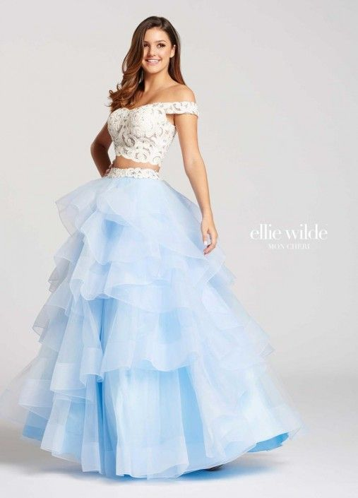 9d4681aef116 Style EW118040 from Ellie Wilde for Mon Cheri is a formal two piece off the shoulder  Tulle and Lace long tiered ruffle Prom gown.