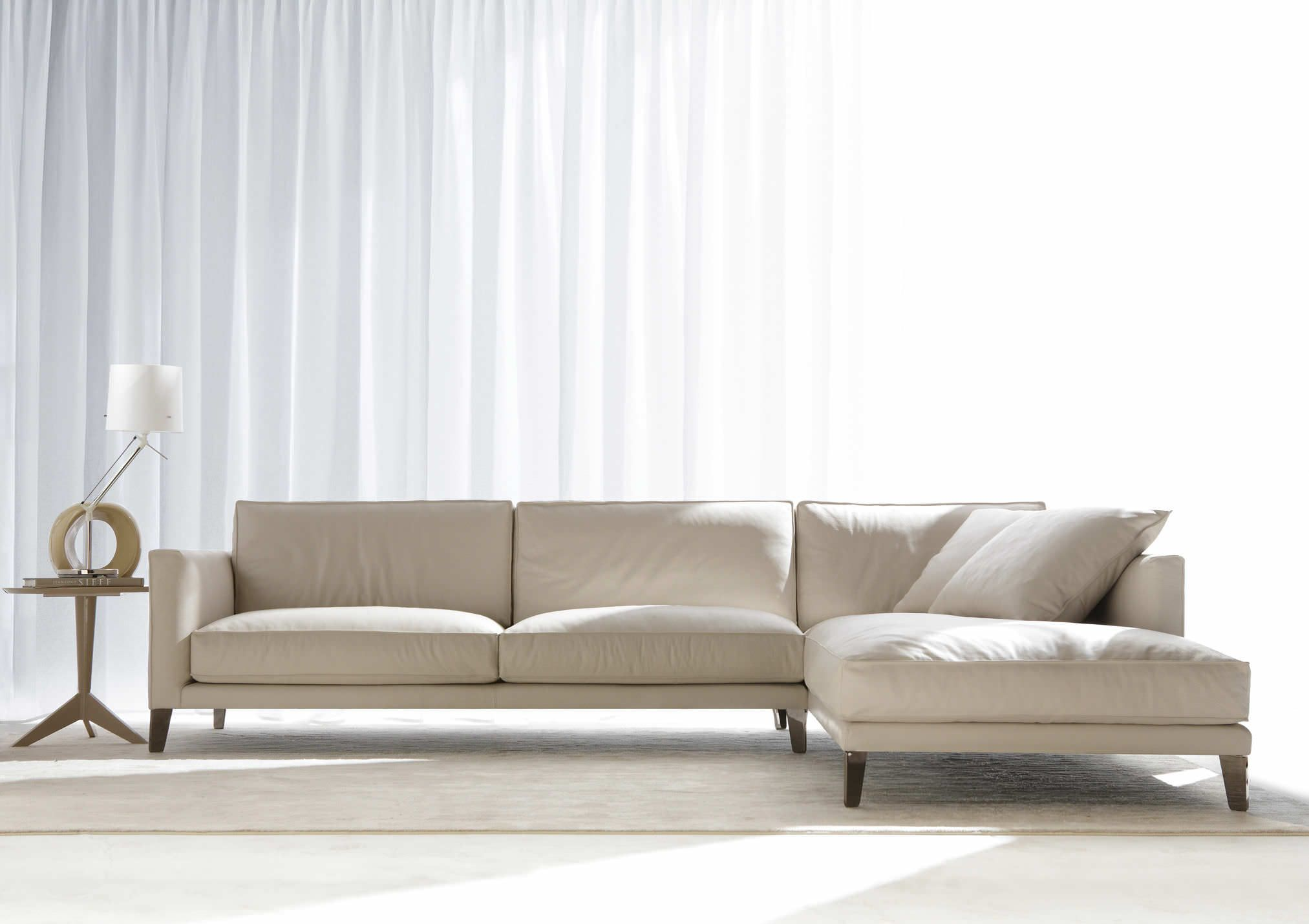 Cozy Living Room Design With L Shaped White Linen Fabric