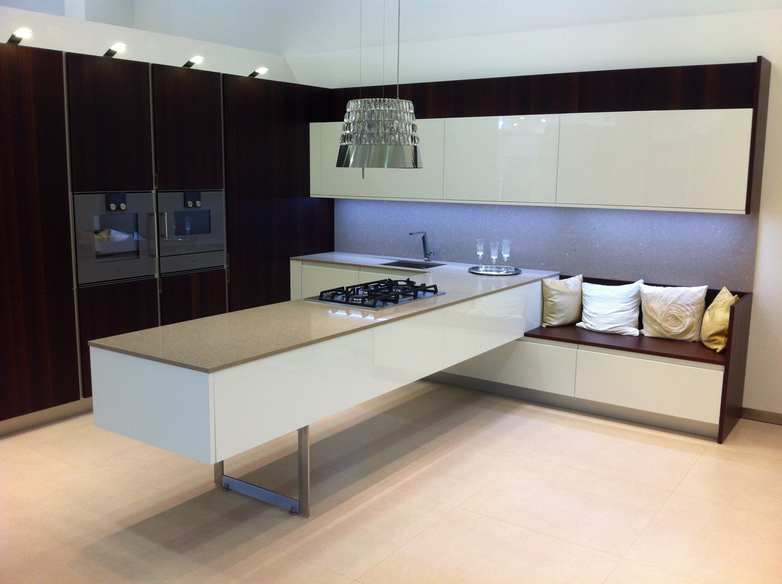 Floating kitchen island with built-in sofa  Floating kitchen