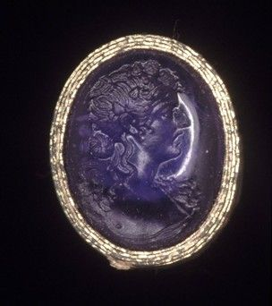 Amethyst intaglio engraved with the head of a maenad wearing an ivy-wreath.