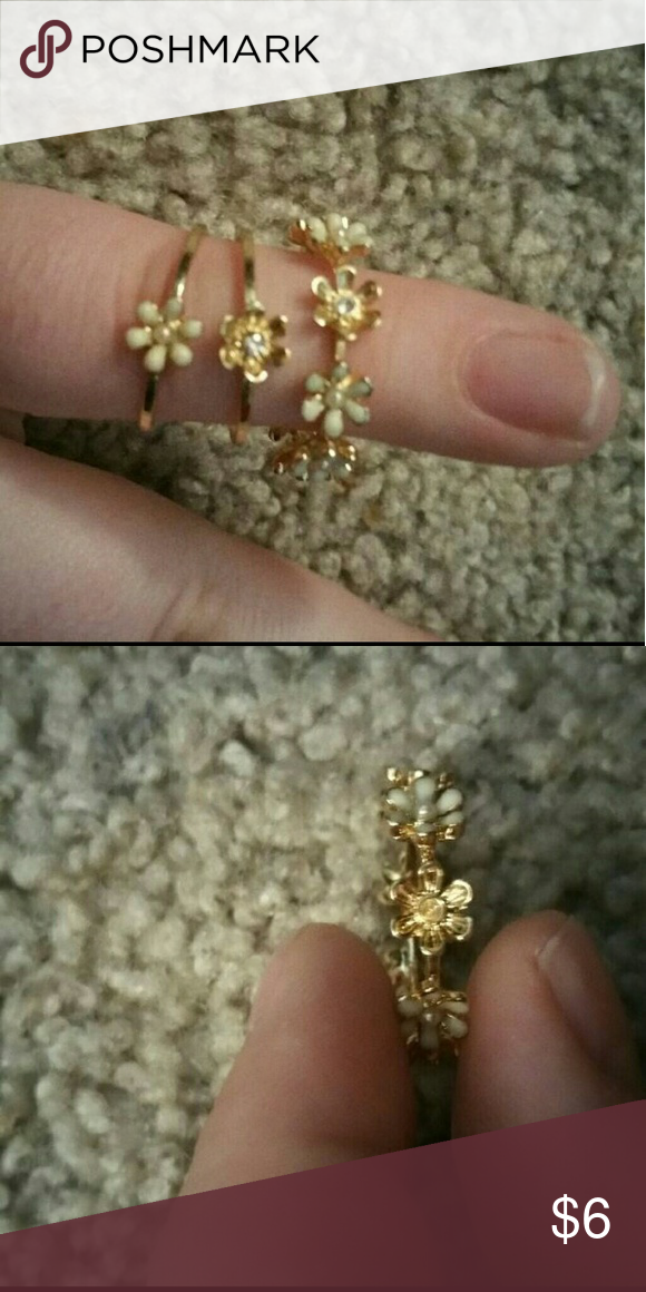 3 Ring Set 3 rings with flowers  One of the flowers is missing a jewel, fell out while being stored (see second photo) Never worn Jewelry Rings