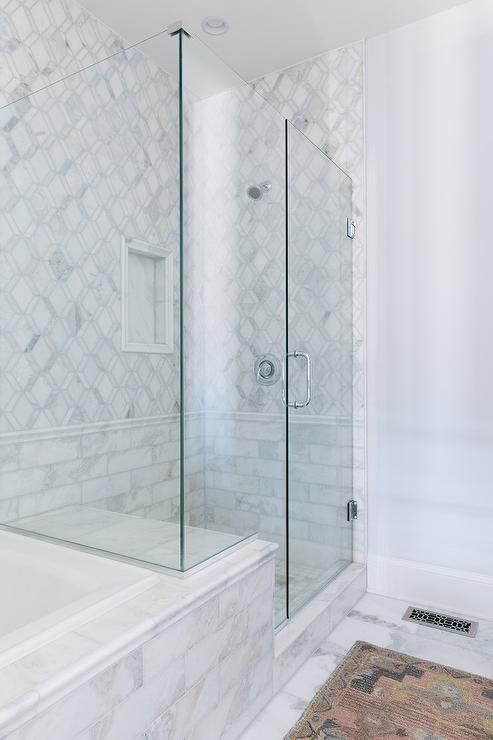 seamless glass shower features marble bench fixed facing polished nickel head mounted to diamond patter white tiles accented wi  also
