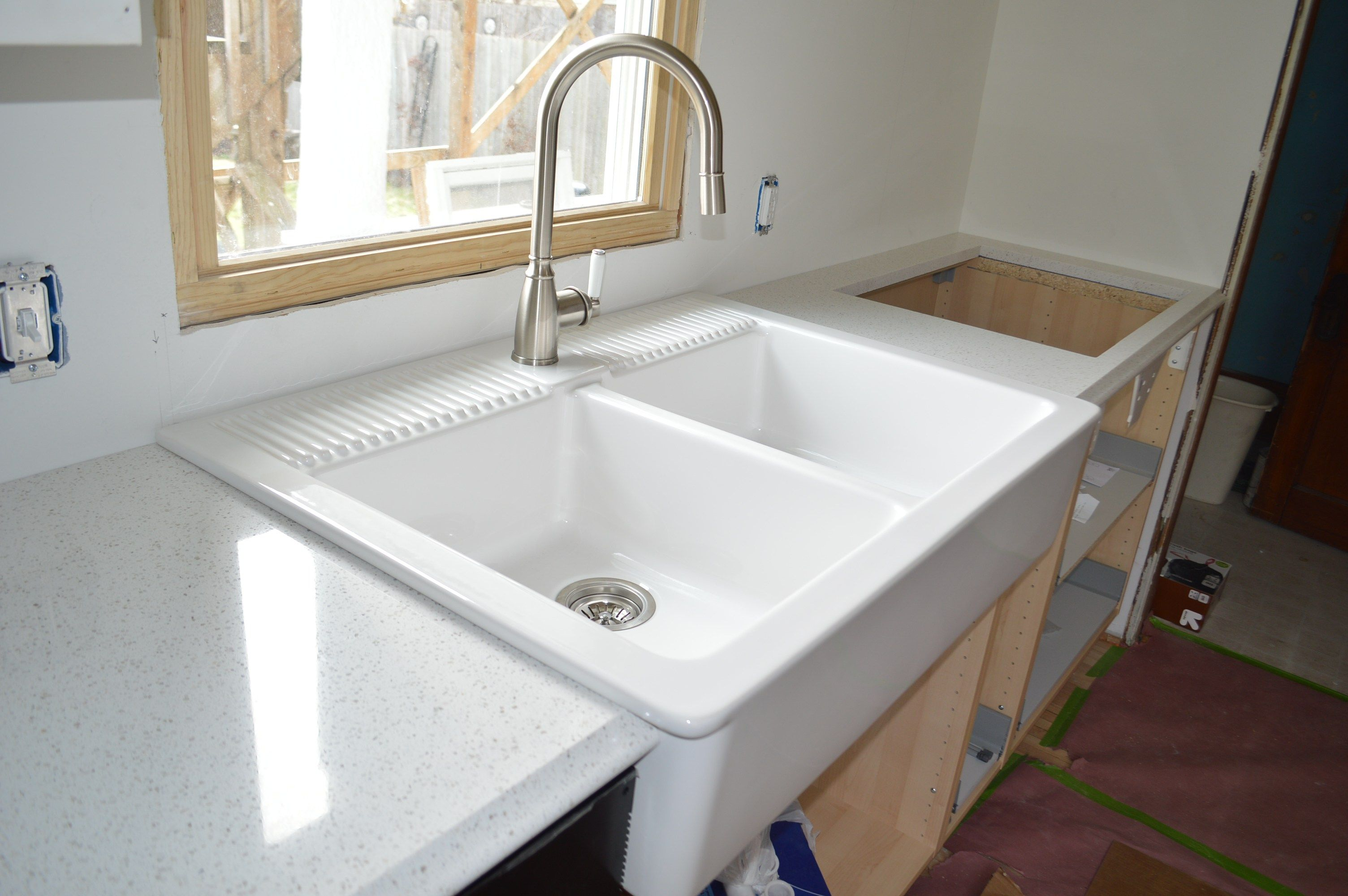 This Sink Actually Sits On Top Of The Counters On Either Side So It Was Really Ikea Farmhouse Sink Quartz Countertops Farmhouse Sink Sink that sits on top of counter