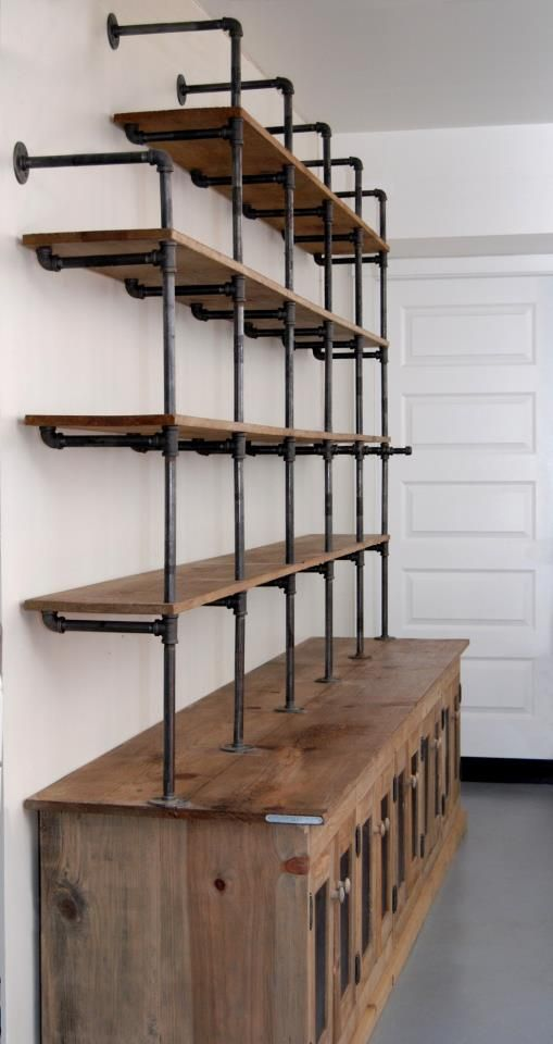 Clever pipe shelving and tin ceiling tile