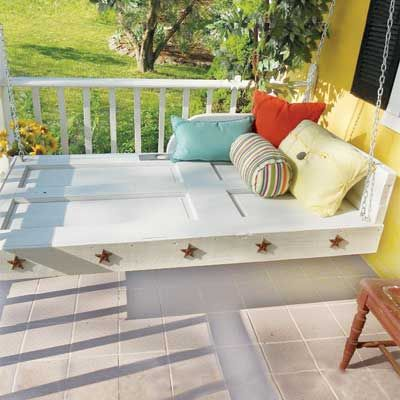 A daybed/porch swing made out of a door!