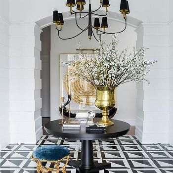 Round Black Pedestal Entry Table With Black Tiered Chandelier Foyer Decorating Round Foyer Table Coastal Decor