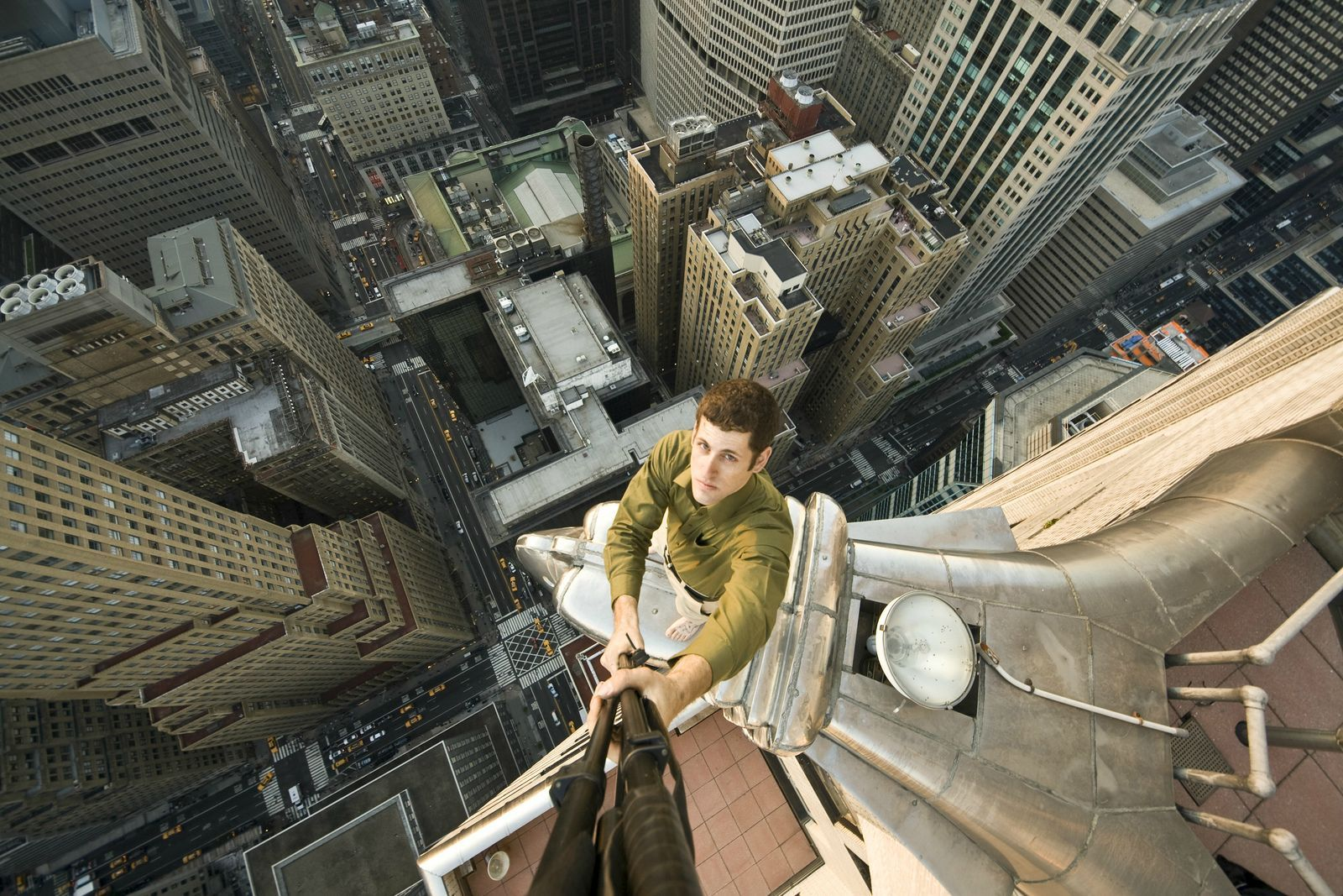 Person Looking Down From A Building