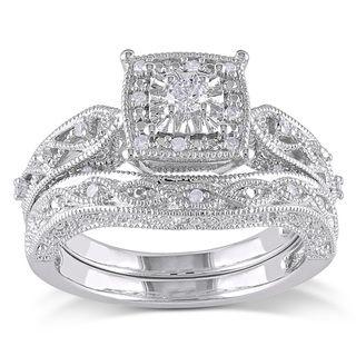 Miadora Sterling Silver 1/5ct TDW Diamond Bridal Ring Set (H-I, I2-I3). It's not white gold like i want but it's dang gorgeous