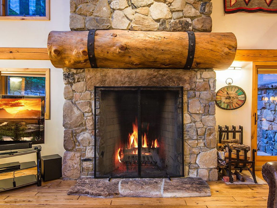 Log home stone fireplaces log cabin fireplace log home for Stone log cabin