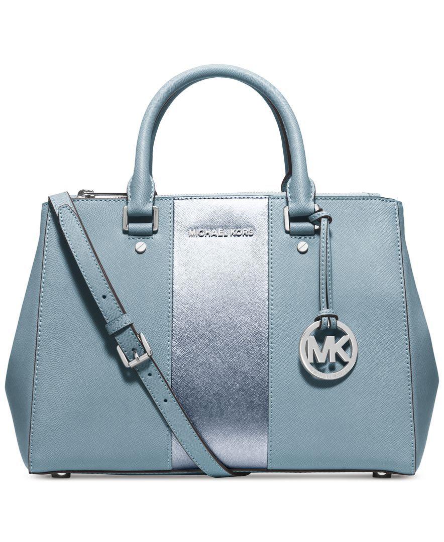Mix and match a MICHAEL Michael Kors handbag, wallet and pom