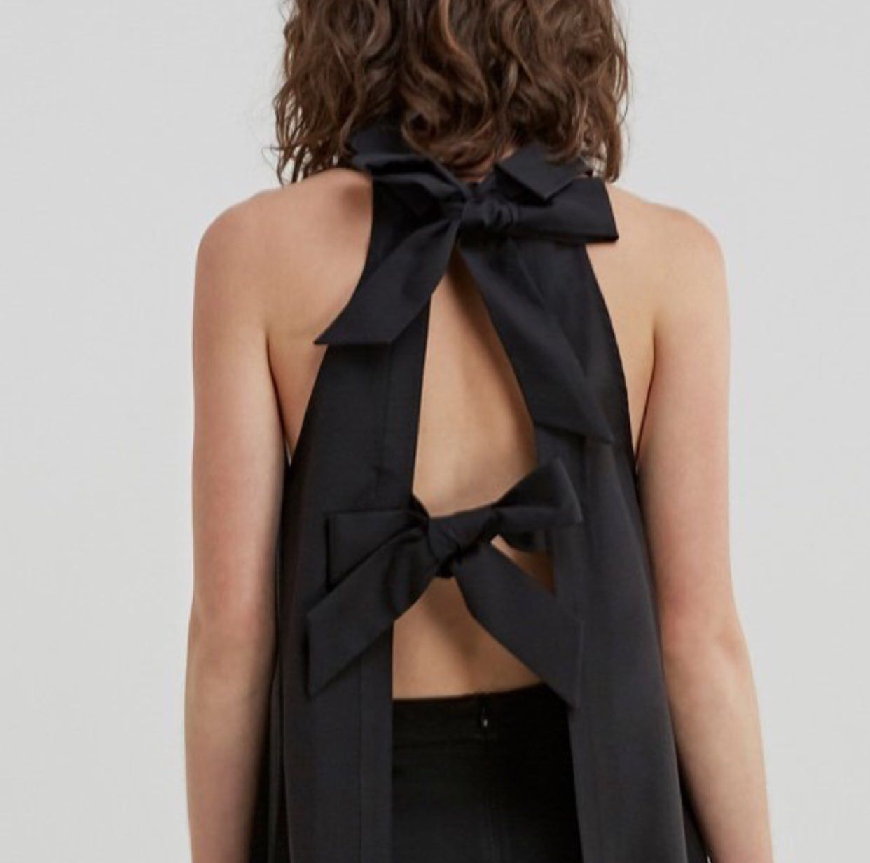 o something a little unexpected and wear this! The classy black bows makes it so elegant but fresh.  STRING ALONG SHIRTING TOP  http://bit.ly/2opQkQG