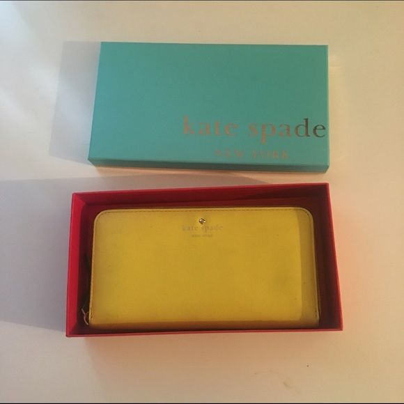 Kate spade wallet Yellow leather Kate spade wallet, 12 card slots, dimensions are 8 by 4 by 1 kate spade Bags Wallets