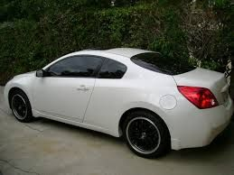 White Nissan Altima Coupe   Black Rims