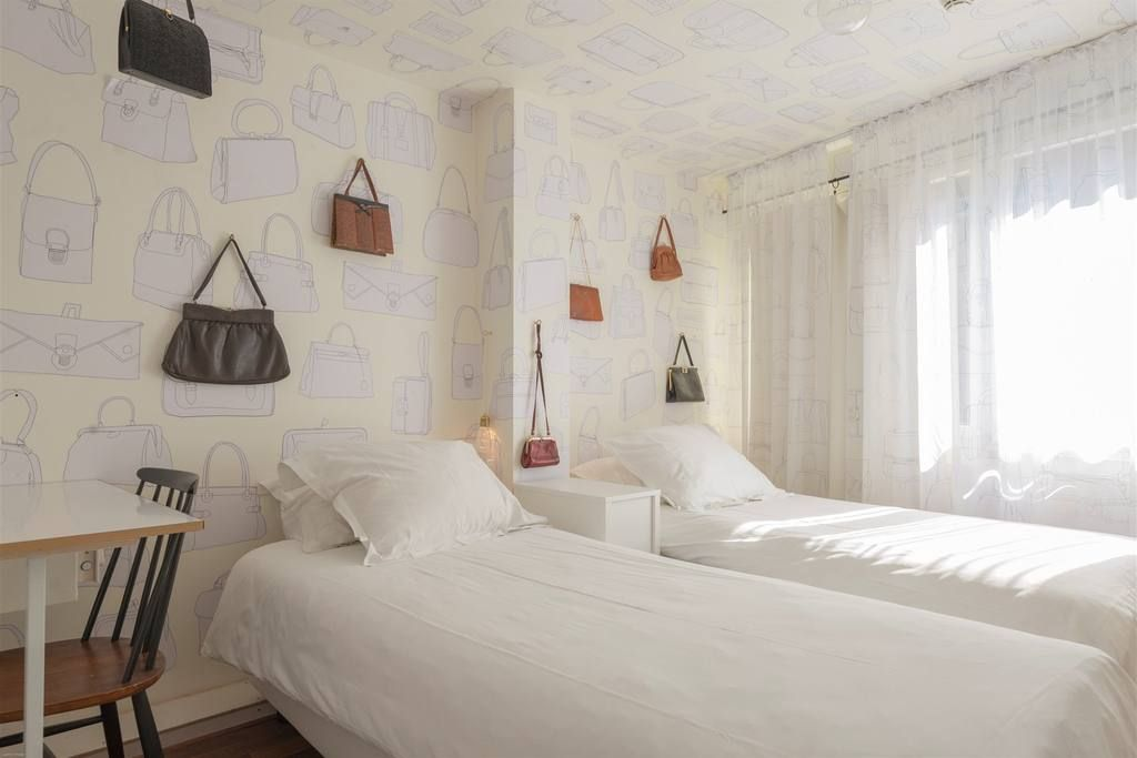 Love this wallpaper and display of vintage bags. Any collection of favourite items could be displayed in a similar way. Inspiration from Hotel The Exchange: fashion hotel in central Amsterdam - Netherlands