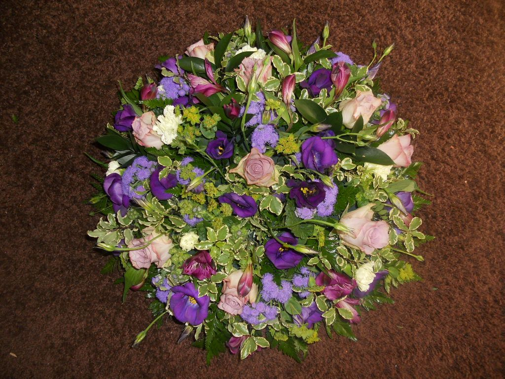 Pretty purple themed funeral wreath flowers for all occasions pretty purple themed funeral wreath izmirmasajfo Choice Image