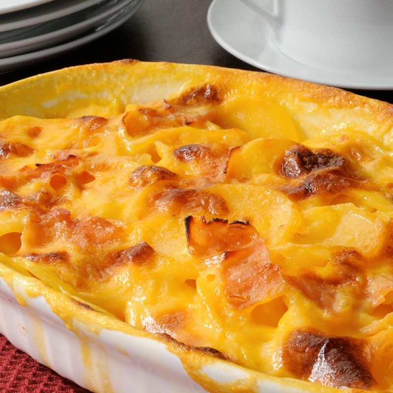 This cheesy potato casserole is a combination of par-boiled potato slices that are covered in a sauce made from sour cream, cream of chicken soup, milk and cheese. Very creamy and very yummy.  This would be wonderful served with baked chicken breasts.