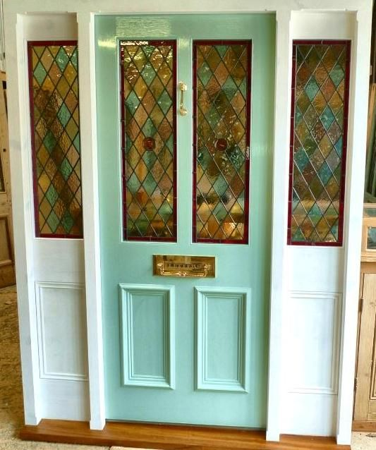 A Stained Glass Front Door With Frame And Sidelights Doors