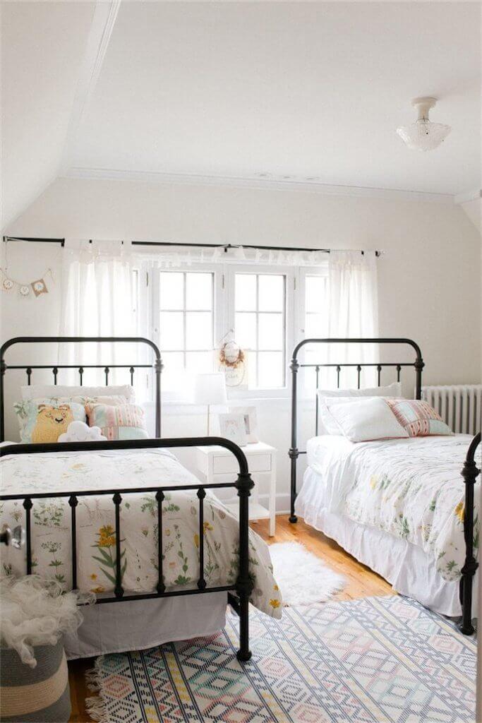 Girls bedroom with metal beds!  So cute!