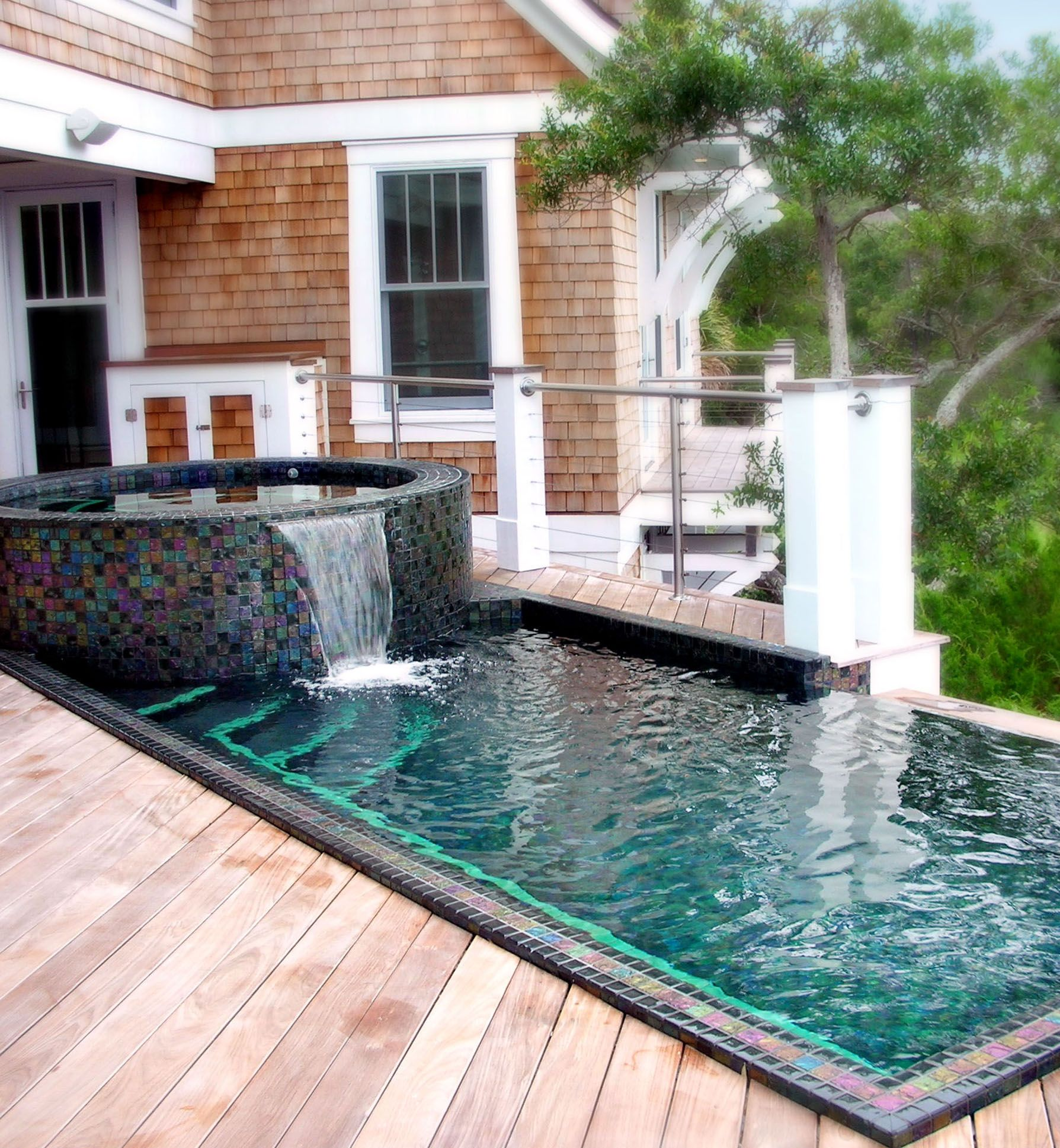 Stainless steel pool and spa on a beautiful home deck ...