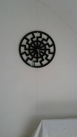 """Meine neue Wanduhr, my new clock   """"Die schwarze Sonne"""" (The black sun) nach § 86a StGB in Deutschland nicht verboten."""