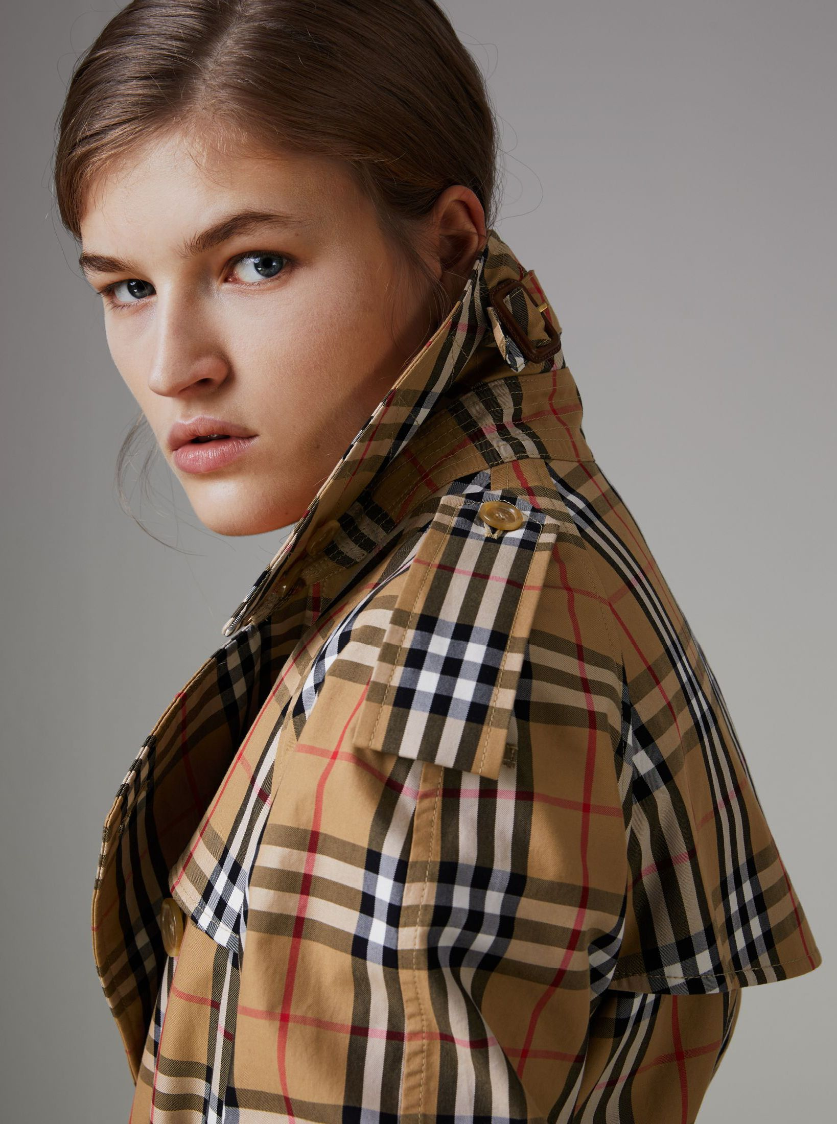 A burberry trench coat in english woven vintage check cotton inspired by a print first used in the 1960s the relaxed raglan cut has a pronounced storm