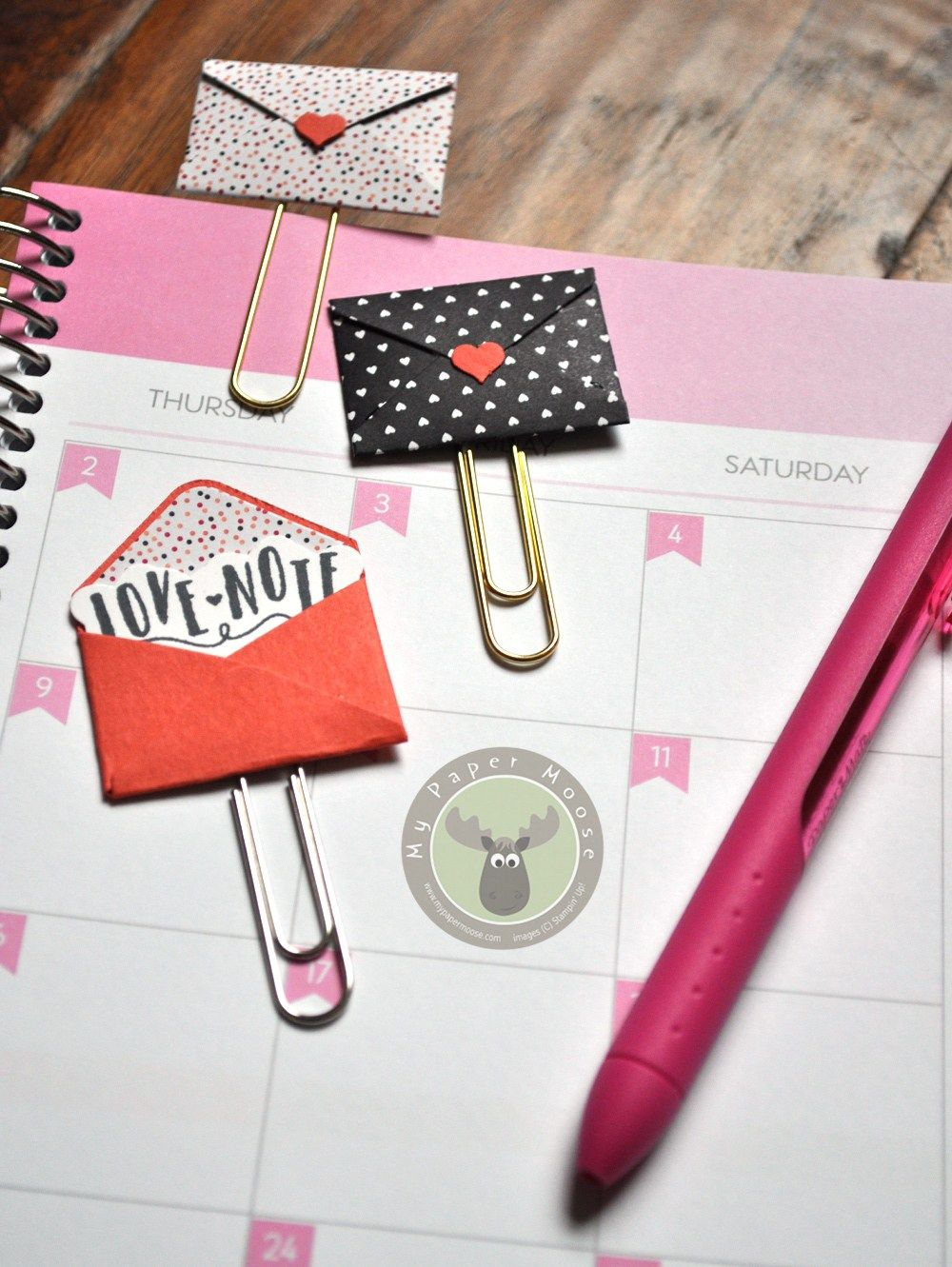 cute mini envelope paper clips make the perfect bookmarks or