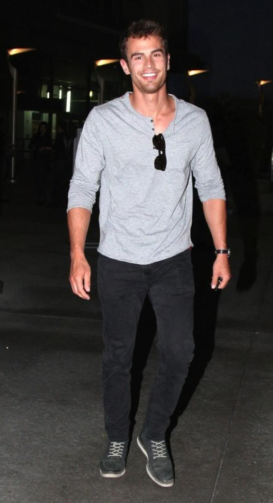 Dress Like Theo James - Unlike his role in Divergent, Theo James blends into the crowd quite nicely with a monochromatic look. He pulls it off with black Levi's 511 slim-fit jeans, a gray Hanes henley t-shirt, Stance Cano socks, and CLAE Evans shoes. Theo James also sports a watch like the Timex Easy Reader and SW polarized sunglasses.