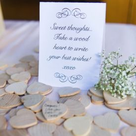 What a cool guestbook idea! This couple asked guests to write well wishes on wooden hearts! Photo by Blush Wedding Photography.