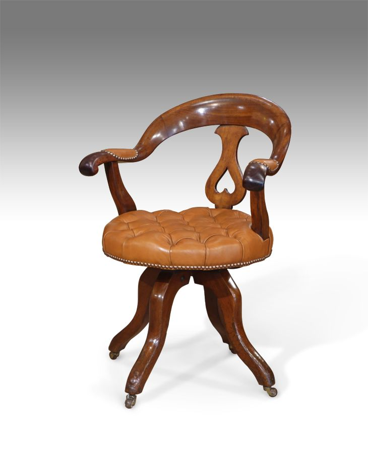 Antique captains chair 19th century mahogany revolving captains chair.  Shaped back, with pierced splat and scrolling arms. The leather button seat,  ... - Antique Captains Chair 19th Century Mahogany Revolving Captains