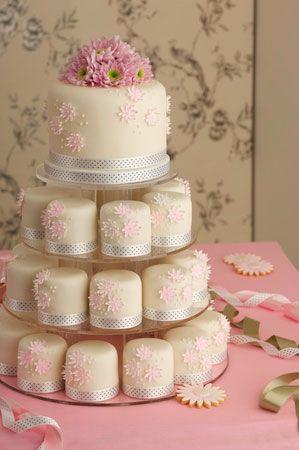 """Pink Bloom"" mini-cakes from Maisie Fantaisie, London. Madagascar vanilla bean cake, vanilla bean buttercream, raspberry preserve, VV Rouleaux ribbon, handmade sugar flowers."