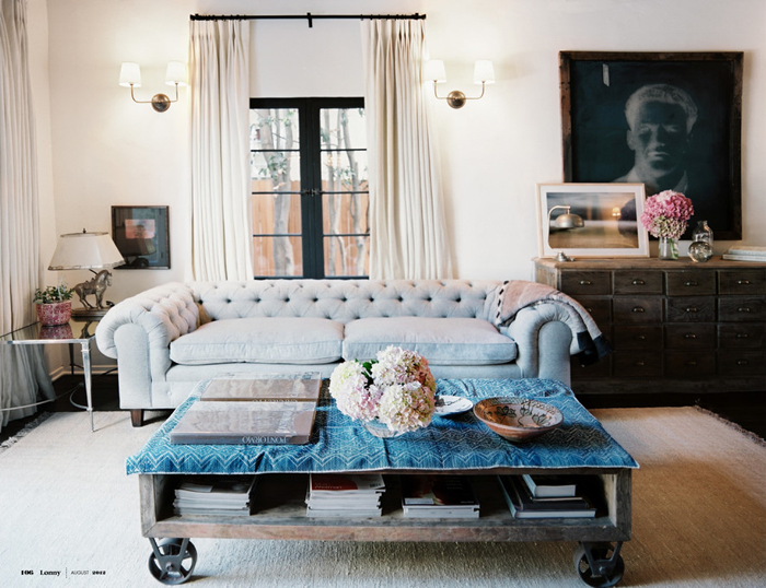 A romantic tufted grey sofa with rustic and industrial furniture ...