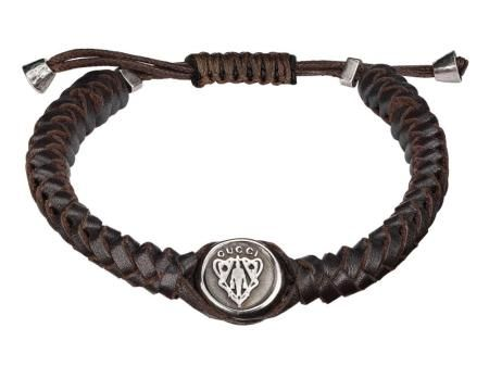 dbcccbcd7 Check out this Gucci woven leather bracelet with Gucci Crest tag in dark  brown leather and sterling silver with palladium aging finish!
