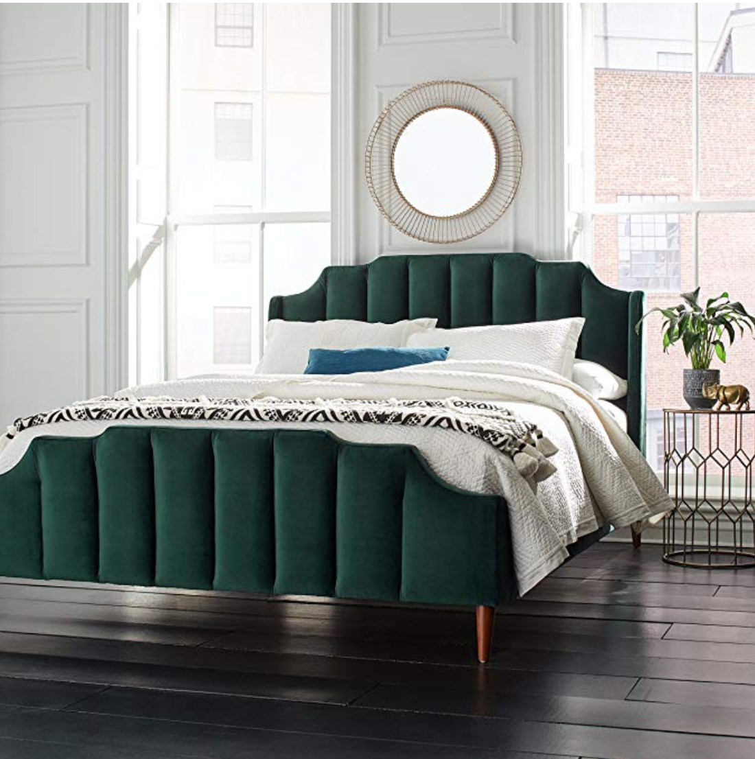 Emerald Green Velvet Bed With Black And White Textured Bedding And