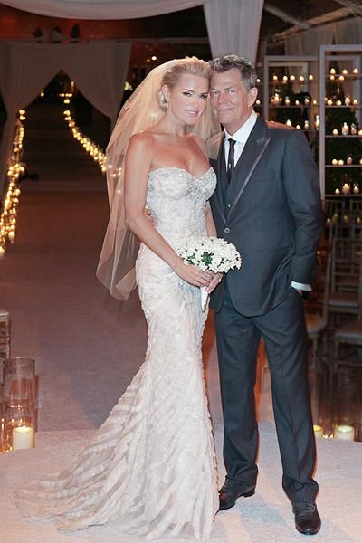 Like Hair And Silhouette Of Dress And Long Array Of Candles In Background Wedding Dresses Celebrity Bride Celebrity Wedding Photos