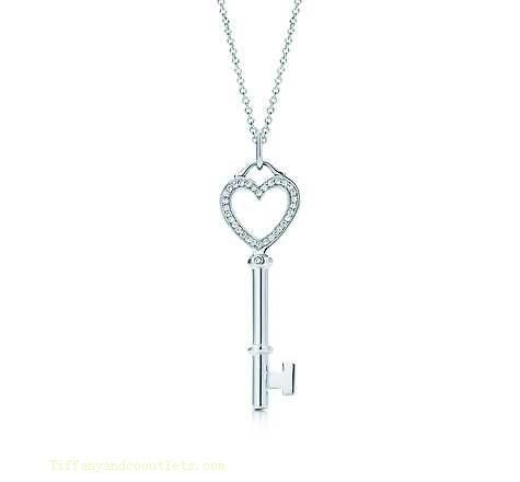Unique tiffanys round shaped wedding engagement ring with a shared tiffany co outlet keys heart key pendant jewelry on a long chain aloadofball Image collections