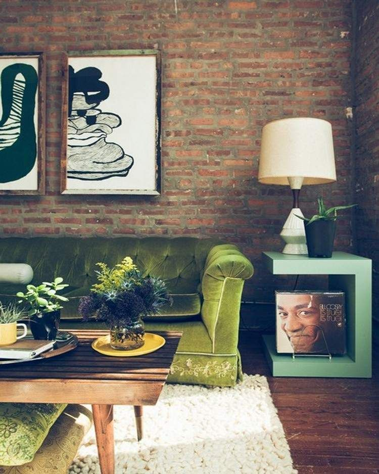 Soft+green+velvet+sofa+and+exposed+brick+wall+-+living+room