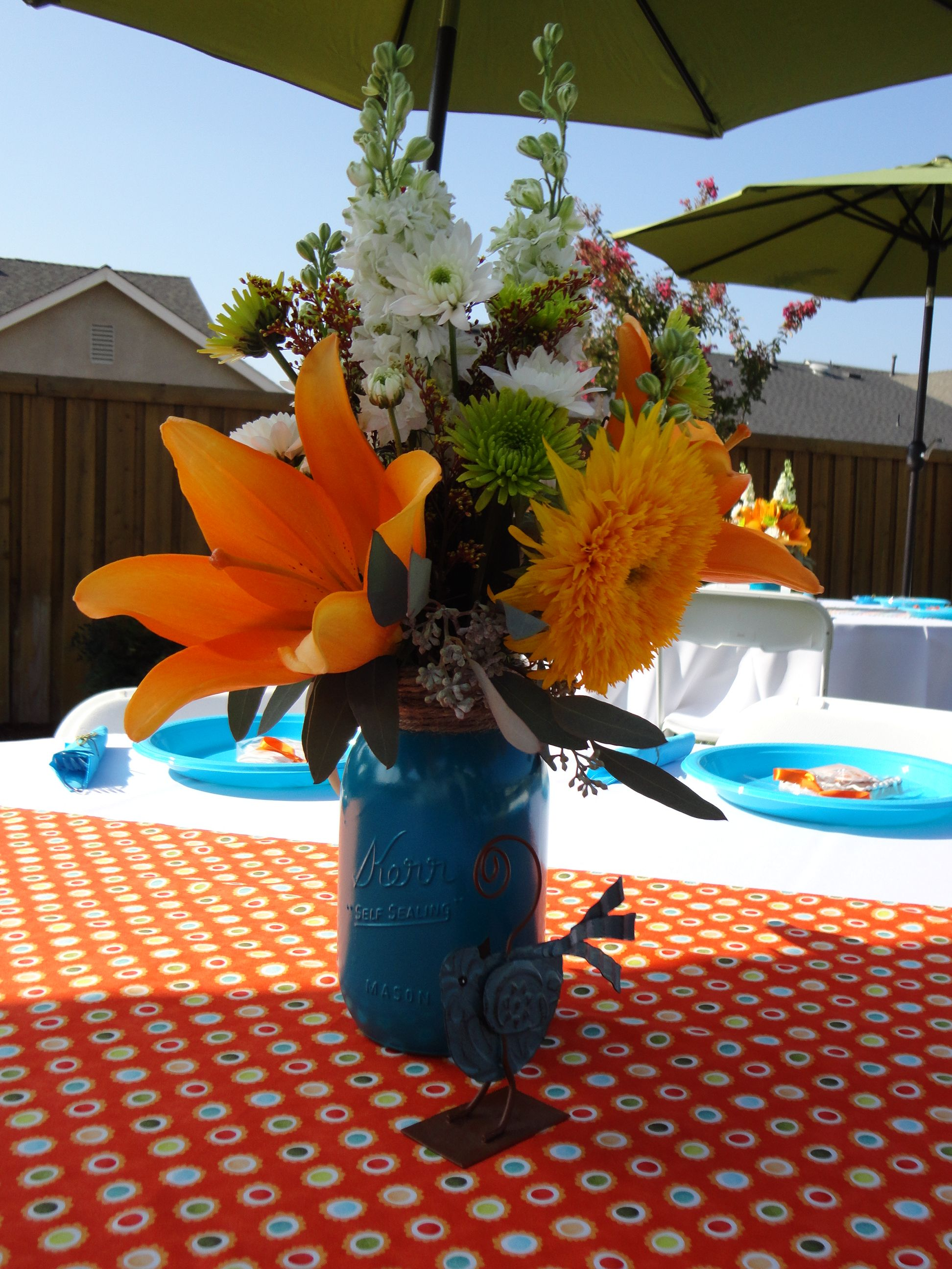 Dyi mason jar centerpieces for a orange and blue baby shower spray