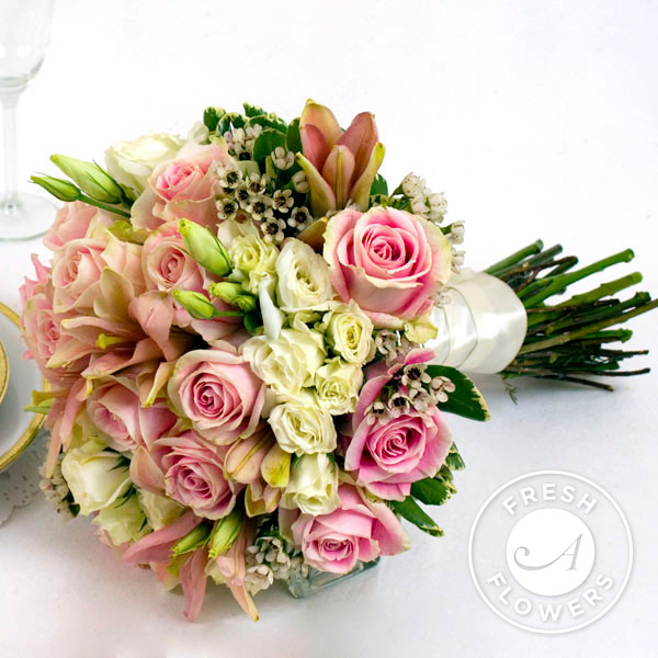 lilies, various sizes of roses and accenting greenery and filler ...