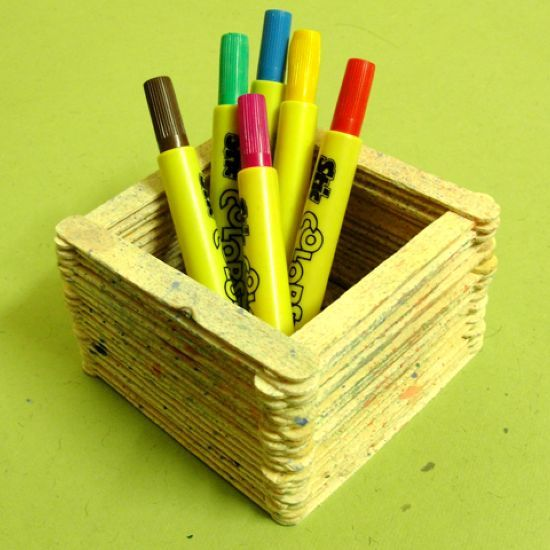 How to make a pen stand out of popsicle sticks via @Guidecentral - Visit www