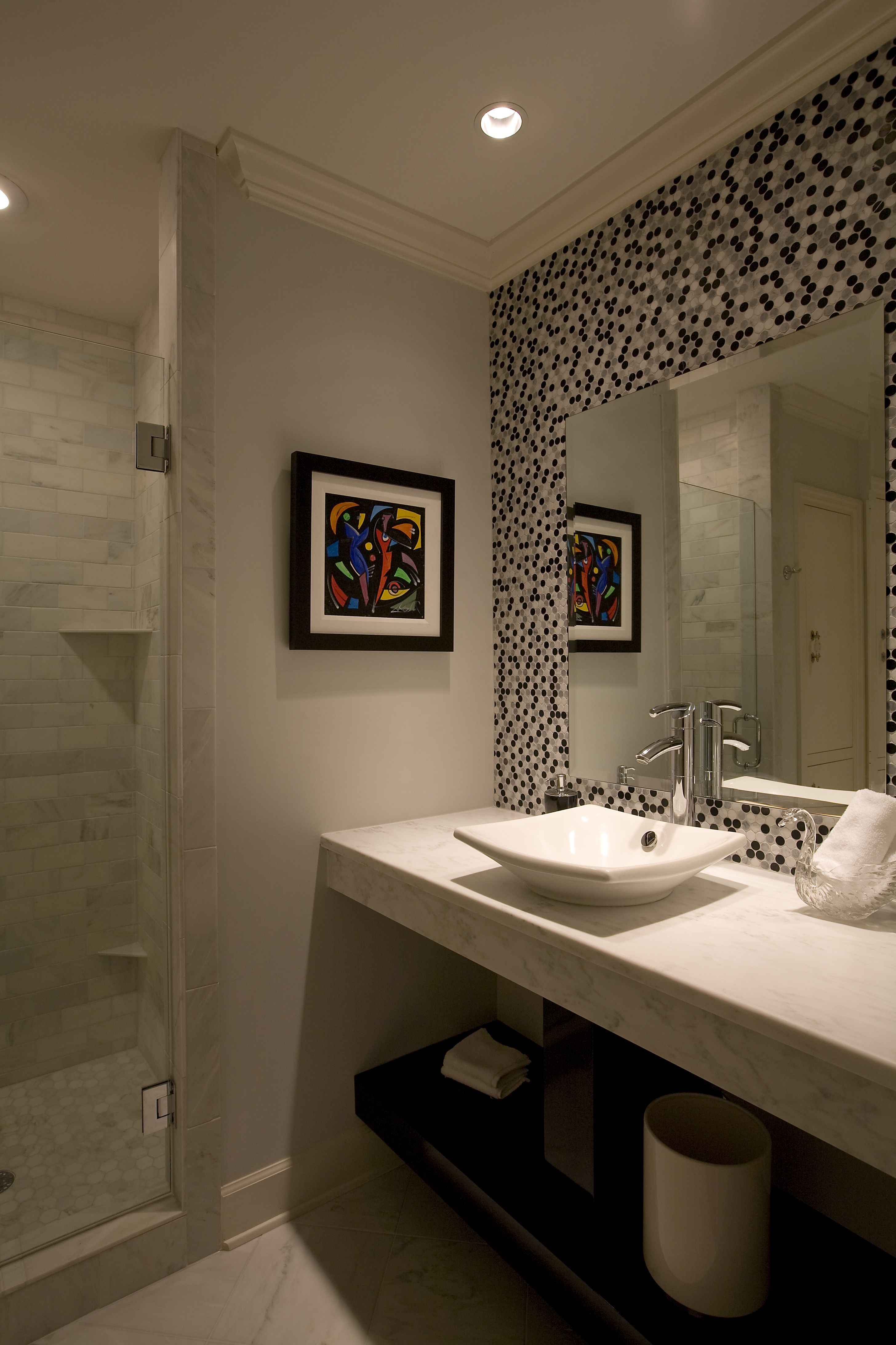 Black & white tiles and a vessel sink add to the ambience for this ...