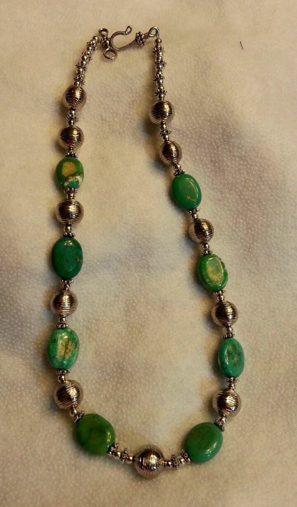 A personal favorite from my Etsy shop https://www.etsy.com/listing/246223893/green-stone-and-silver-toned-necklace