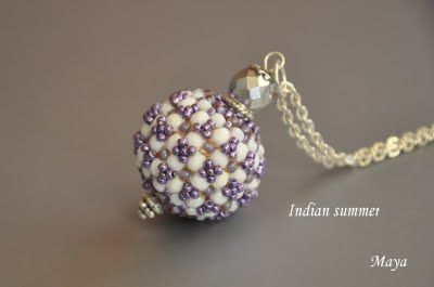 Beaded bead tutorial.  How to make a wooden bead into something special. There is no way to translate this, but if you go to the page then click on the photo of the tutorial the photo then comes up large and I think it is fairly easy to follow the photos from there.