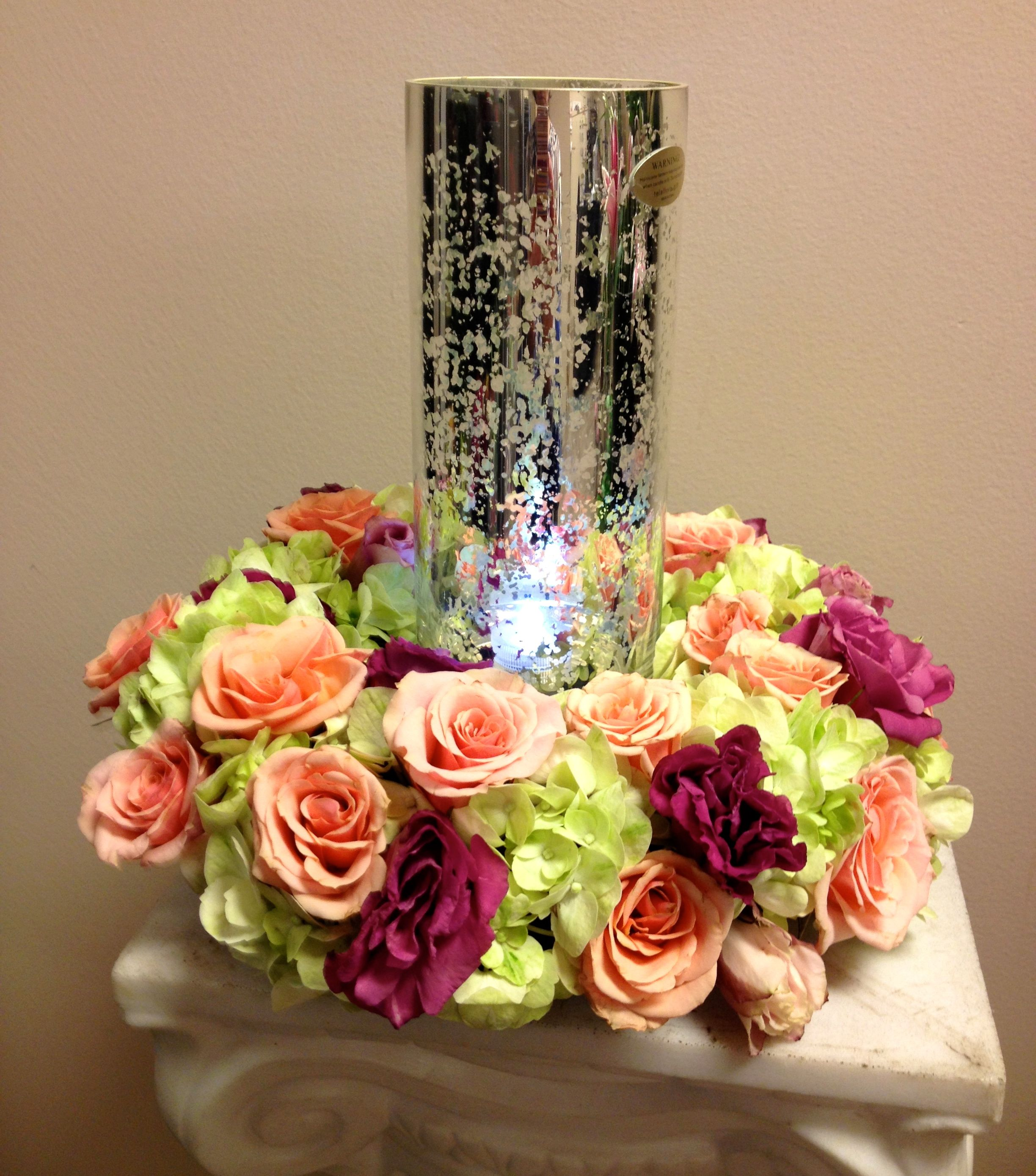 Candle Flower Centerpieces Wedding: Lovely Wreath Of Flowers Around A Glass Hurricane Candle