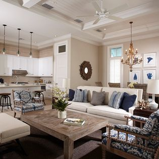 Use a navy blue upholstered ottoman and paint the ceiling tray insert a muted blue  Bent Palms - beach-style - Living Room - Miami - Kukk Architecture & Design P.A.