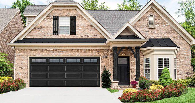 With A Traditional Home Design These Black Garage Doors Are Elegant And Trending Garage Door Design Garage Door Styles House Exterior