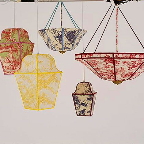 Think outside the box in all matters toile. These toile lanterns add just the right amount of unexpectedness to any interior. Per Traditional Home Magazine