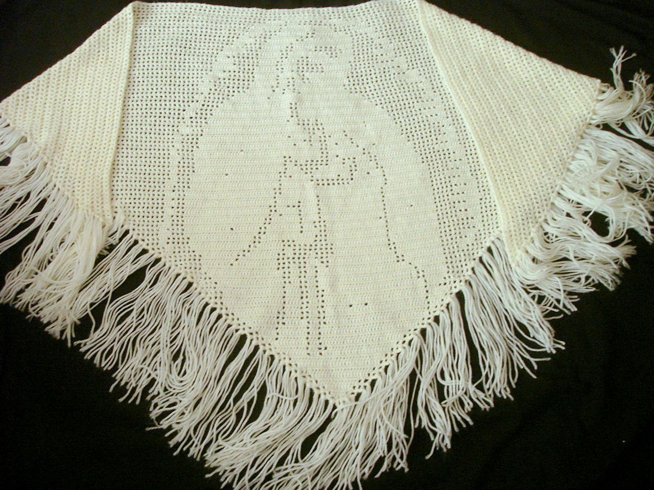 A friend crocheted this shawl.  See the Blessed Mother?  It is for the raffle for the Knights of Columbus / Ladies Auxiliary Christmas Party