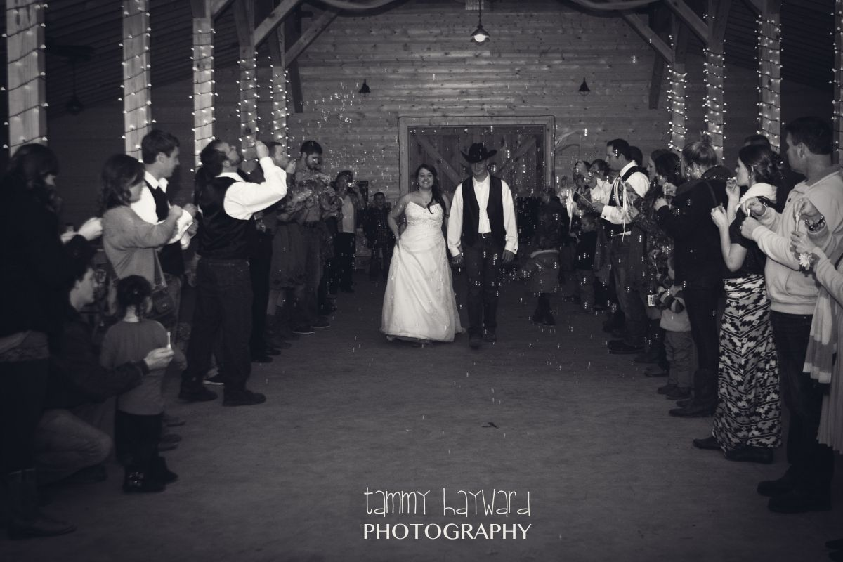 Bubbles were blown at the couple as they made their way through family and friends at this December wedding.